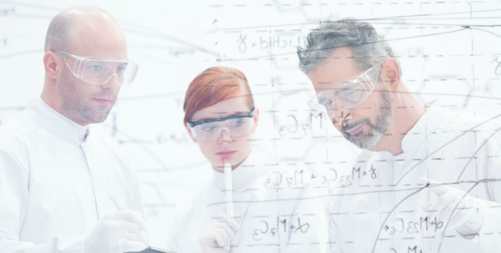 close-up of tree people in a laboratory analyzing data from a whiteboard